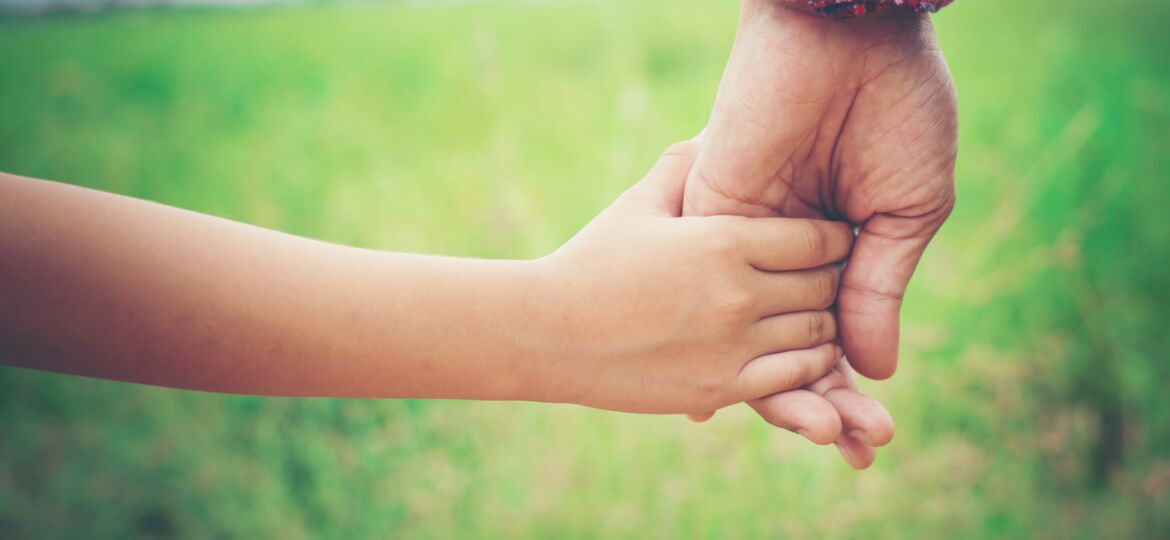 close-up-father-holding-his-daughter-hand-so-sweet-family-ti-scaled